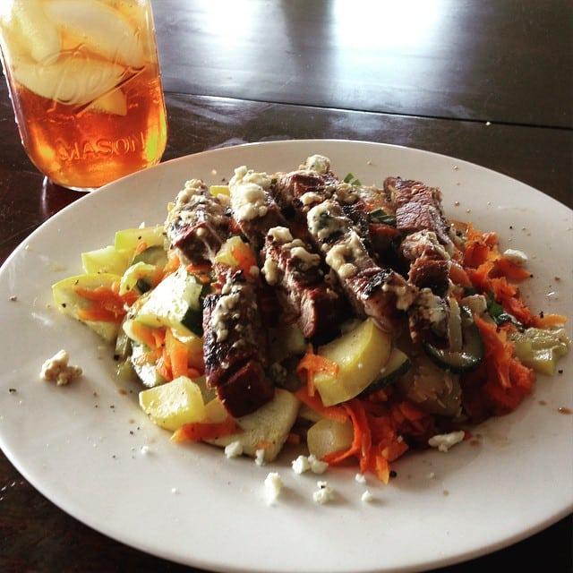 Steak over grilled vegetables